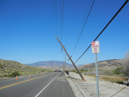 Looking west at the Highway 138 road closure and snapped power pole. [photo by Jeff Zimmerman]