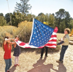Students at Pine Mountain Learning Center prepare to raise the new flag.