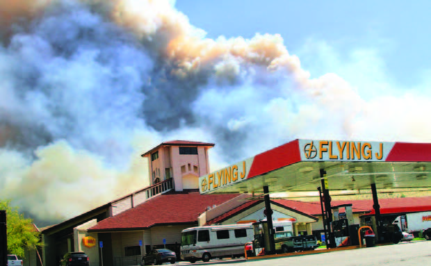 The Grand fire rages across the hillsides behind the Flying J truck stop. [Jeff Zimmerman photo]