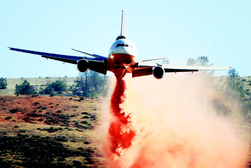 A DC-10 drops retardant during a very low pass over the Powerhouse fire. The fire started May 30 in the Green Valley area and quickly gained momentum, devouring over 32,000 acres. [photo by Jeff Zimmerman]