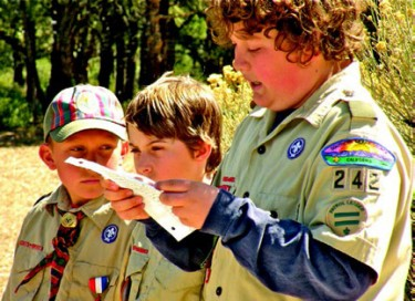Gabriel Wilde reads his speech, with scouts from troop 242.