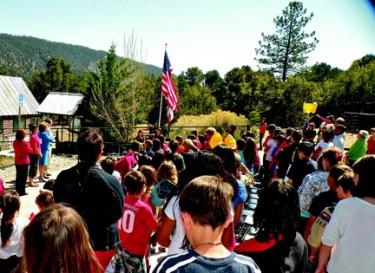 Students reciting the Pledge of Allegiance at Pine Mountain Learning Center.