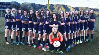 """The Frazier Mountain High School girls soccer team didn't win the High Desert League top spot. They tied for second. But something happened when they got into play-offs. """"The team just got better and better,"""" said Coach Sharon Lemburg.   See their story on page 28. [Taylor Mason photo]"""