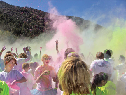 "Top and right, At the grand finale celebration of the ""Color the Mountain 5k Run"" fountains of color soared into the air. [photo by Patric Hedlund]"