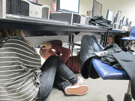 Students in Mrs. Heasley's journalism class at FMHS immediately took cover under their desks as the alarm sounded at 10:17 a.m. on Thursday, Oct. 17. [photo by Gary Meyer]