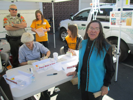 ETUSD Trustee Anita Anderson drops off her expired medications at the MCCASA Take Back booth at Frazier Park Market. [photo by Gary Meyer]