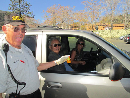 "At times the operation became a ""drive-thru"" with citizens handing over their old medications through the car window. [photo by Gary Meyer]"