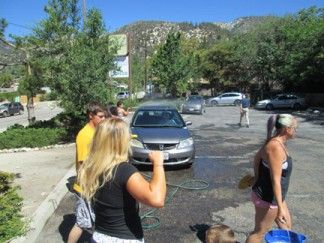 The benefit car wash is underway now at The Mountain Enterprise parking lot. [photo by Gary Meyer]
