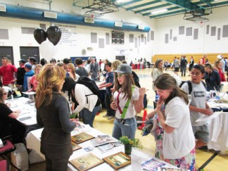 Patric Hedlund, editor of The Mountain Enterprise speaks with job seeker at the FMHS Career Day. [photo by Gary Meyer]