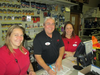 Ace Hardware's Captain Harry Spyrka (center) marks our treasure map with help from first mate Randi (left) and quartermaster Robin (right).