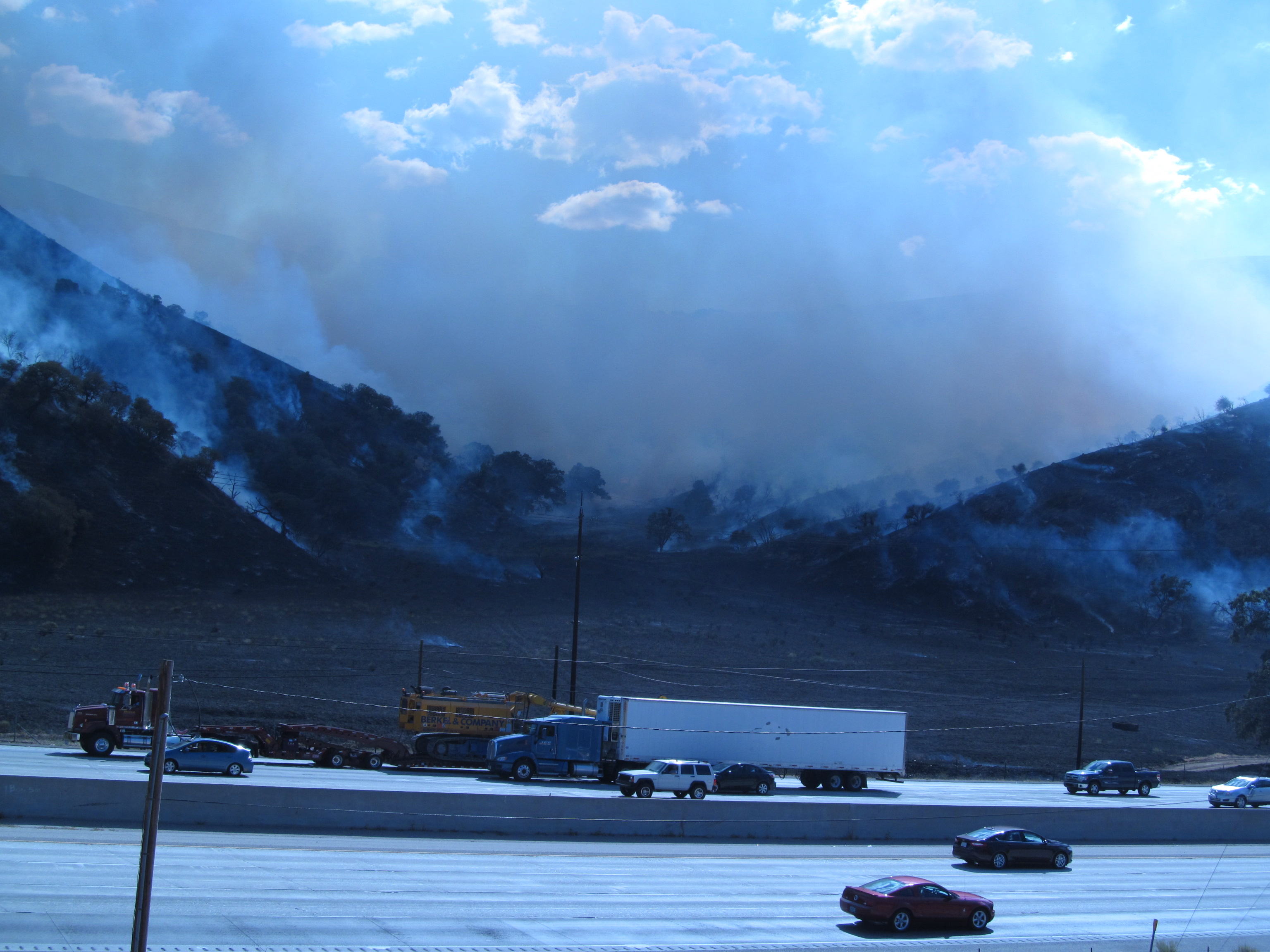 A heavy cloud of smoke is seen from the Interstate 5 Lebec Road overpass in this photo by Shelly Borgstrom of Frazier Park. the photo looks across the interstate, toward O'neill Canyon, Lance Borgstrom reports.