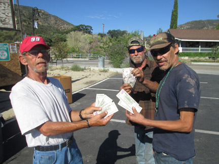 Randy Whitbread, 'Just plain David' and Robert Singleton took away $41 cash in exchange for their cans and bottles. [photo by Gary Meyer]