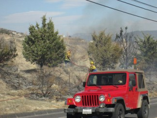 Kern County firefighters work to extinguish flames along Frazier Mountain Park Road in Lebec. [photo by Gary Meyer]