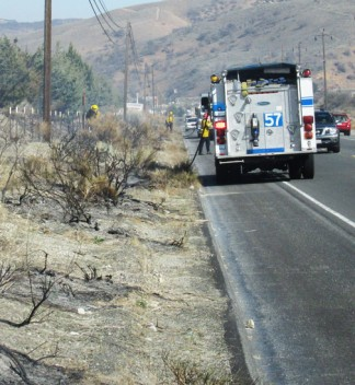 Numerous small fires had started along the highway in Lebec, just east of Frazier Park. [photo by Gary Meyer]