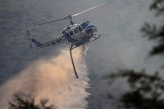 Chuck Noble caught Kern County Fire Department's helicopter 407 making a water drop near his home in O'Neill Canyon.