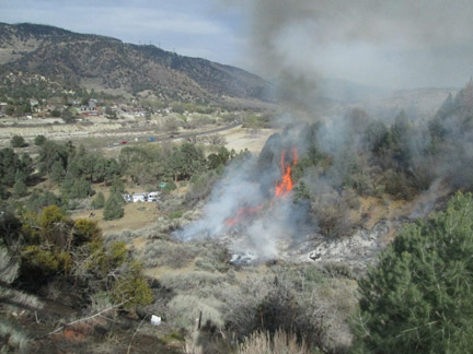 A wide view of the fire on the west end of the Tait Ranch property. [photo by Gary Meyer]