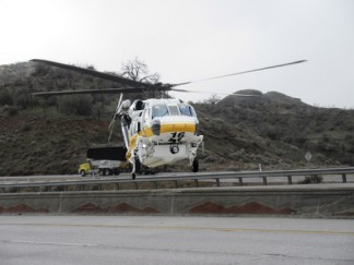 An L.A. County Medevac helicopter lands on the southbound Interstate 5 lanes. [Photo by Gary Meyer, The Mountain Enterprise]