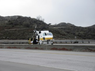 Emergency crews load the patient into L.A. County Medevac 16. [photo by Gary Meyer, The Mountain Enterprise]