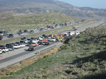 The scene at southbound I-5 about two miles south of Gorman School Road. All lanes are closed as the medevac helicopter prepares for takeoff. [photo by Gary Meyer]