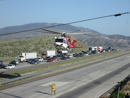 The LA County Fire Department medevac helicopter lifts off from I-5 south of Gorman. [photo by Gary Meyer]