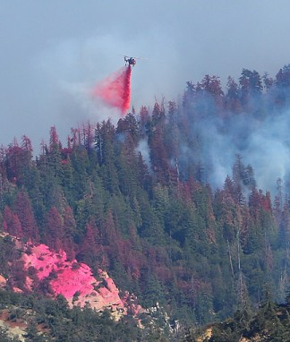 An Erickson sky-crane helicopter drops retardant on the Pine fire, July 7. [photo by David Slinker]