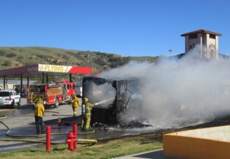 Kern County fire crews knocked down the flames from this motorhome fire at Flying J within a few minutes of their arrival. {photo by Gary Meyer]