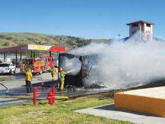 A RV fire at Flying J last week (top left and above) triggered community discussion about safety preparedness at Flying J and how often RVs burst into flames at the top of the Grapevine. [photo by Gary Meyer]