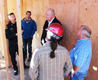 Fire Chief Brian Marshall, District 4 staffer Ryan Schultz and Supervisor Couch stopped by to check on construction progress on Monday, Dec. 23. [photo by David Brust]