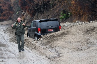 Mud and rock slides in the Power House burn area just south of the town of Lake Hughes on Lake Hughes Road. Los Angeles County Firefighters and Sheriff Search and Rescueare helping to remove vehicles trapped in the debris flow . Hillsides are starting to slide onto Lake Hughes Road and along Elizabeth Lake Road. [Jeff Zimmerman photos]