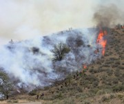 Grand fire 100 percent contained