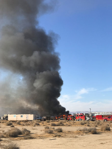 A fire structure fire burns near Antelope Acres at 40th Street West and Avenue C in Lancaster. Los Angeles County Fire Department responded to the scene. [Photo by Jeff Zimmerman]