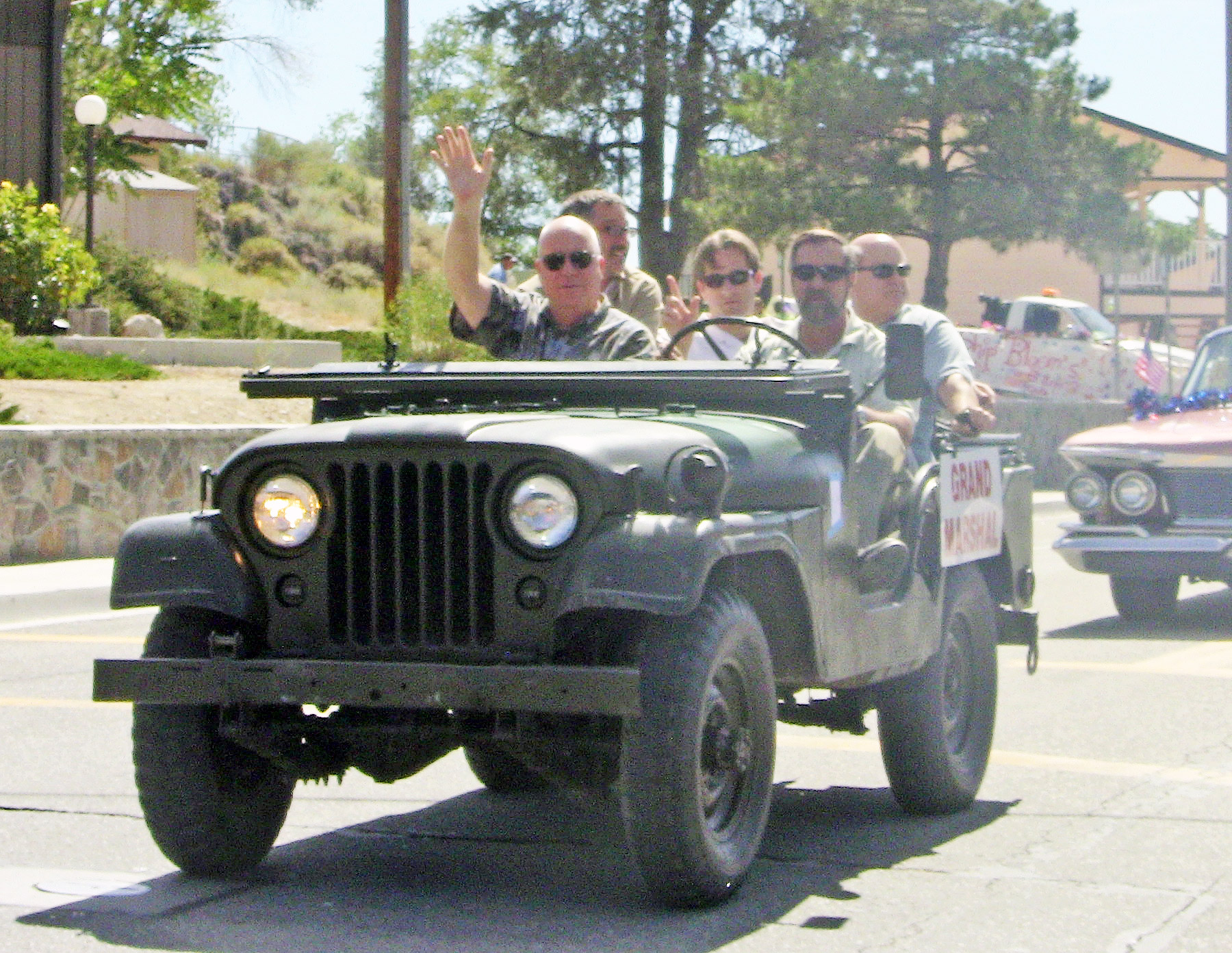 Kern County Supervisor David Couch cruises through the parade in a WWII era Jeep. [photo by Gary Meyer]