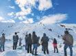 Residents shovel as visitors play