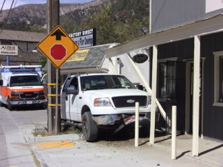 A white Ford pickup truck barely missed a telephone pole and a building at Mt. Pinos Way and Pomona Trail this morning. [photo by Gary Meyer]