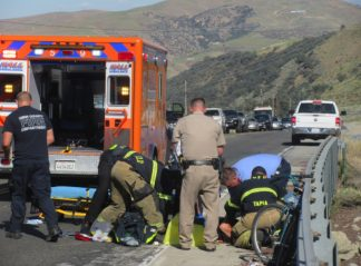 This photo, taken shortly after 5 p.m. on Friday, July 12 is emergency responders preparing Kate Donahue to go to the hospital. She was riding a bicycle on Frazier Mountain Park Road and reportedly hit by a motorist, though that has not been confirmed with CHP as of Sunday, July  14. [Gary Meyer photo]