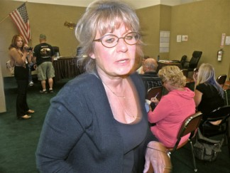 LCWD President Julie McWhorter interrupted her own meeting to call sheriff's deputies June 11 because a reporter took a photo as customers complained about board policies. [photo by The Mountain Enterprise]
