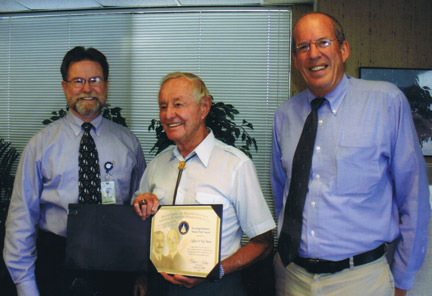 "Clifford ""Kip"" Moné (middle) has been named Honorary Mayor of Fiesta Days for 2013. Here is receives an aviation award in 2006. [Moné family photo]"