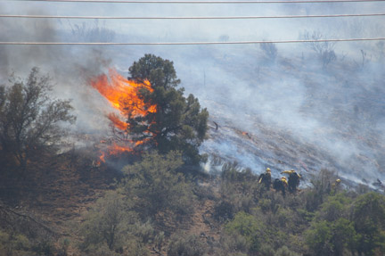 Lance Bergstrom photographed fire crews attacking flames on the hillside near the flashpoint above Frazier Mountain Park Road.