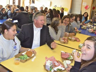 New ETUSD Superintendent Rodney Wallace visits El Tejon School during lunch hour and sits next to Kayla Perry at the 'healthy table' as Perry contemplates her serving of broccoli.