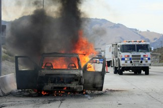 A cargo van exploded near Gorman on the Grapevine about 5 p.m. on Wednesday, July 30. A wildfire about an acre in size was quickly contained by Kern County and Los Angeles County firefighters. [Jeff Zimmerman photo]