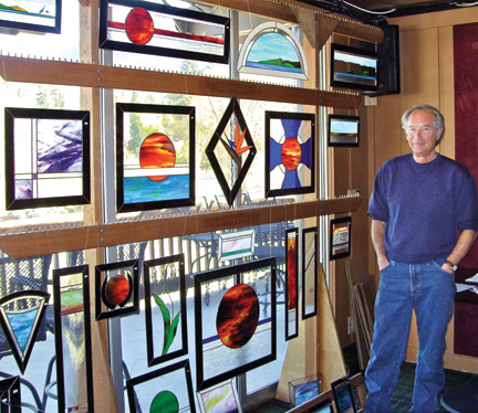 Michael Foster of Pine Mountain works with stained glass. He showed his wares at the Pine Mountain Club Craft Faire Saturday, Nov. 30. [photo by Patric Hedlund]