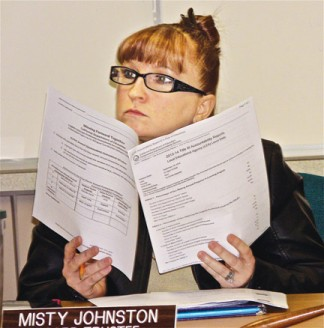 New ETUSD trustee Misty Johnston looks over briefing sheets at data-rich board meeting last week. [photo by Patric Hedlund]