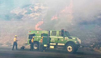 [Angeles National Forest firefighters on scene to knock down flames in the Route fire. Photo by Angeles National Forest.]