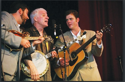 Comedian and banjo player Steve Martin with some of his band.