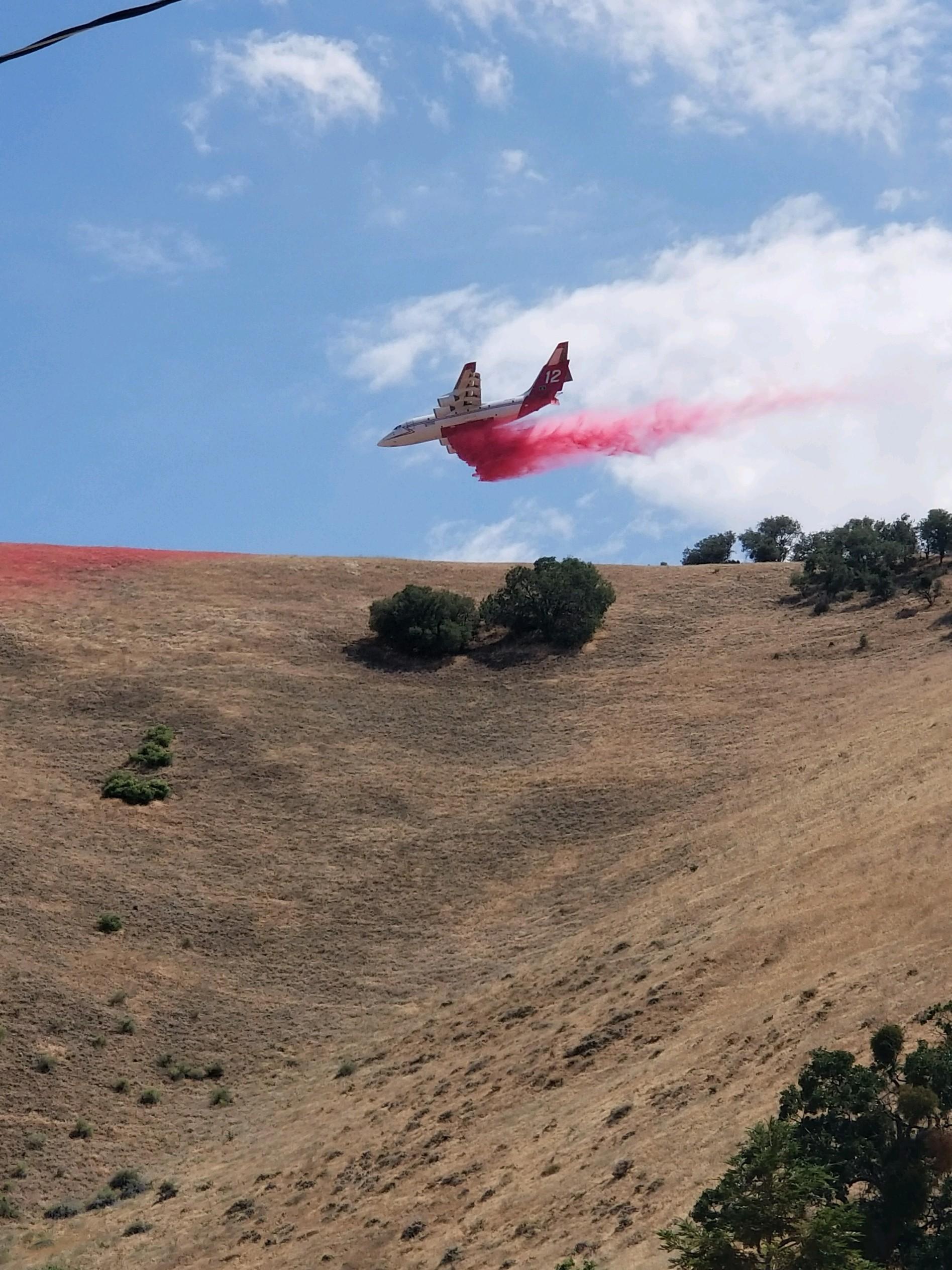 Shane Mead's shot of the BAe-146 dropping retardant.