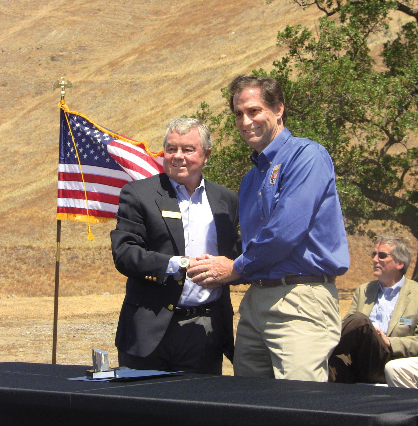 Tejon Ranch Company CEO Bob Stine and U.S. FWS Director Dan Ashe at May 10 announcement of 50-year 'incidental take' permit to shield TRC for condor 'harassment.' [photo by The Mountain Enterprise]