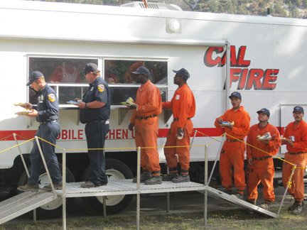 Pam Sturdevant found hundreds of firefighters at Frazier Mountain Park lining up for food at Cal Fire's mobile kitchen.
