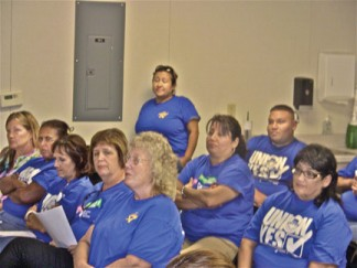 Eleven members of the California School Employees Association—nine of them from Fresno and Bakersfield—came to support a statement by Senior Labor Relations Representative Michael Noland at the ETUSD Board of Trustees meeting Thursday, Sept. 12. Noland threatened the district with a lawsuit over a volunteer reading program for 2nd graders and parents being allowed to help in classrooms while teachers' aides are still laid off. [photo by Patric Hedlund]