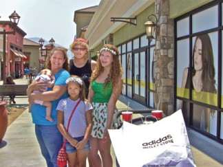 Cristal, infant Stella, Miles, Astoria and Sedona Vivirito of Frazier Park on the opening day for Outlets at Tejon, Thursday, Aug 7. They bought two soccer balls from Mountain Communities resident Matt Martinez who works at the Adidas outlet, Miles said. [Patric Hedlund photo]