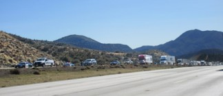 Traffic was backed up for miles on northbound Interstate 5 at Smokey Bear Road while emergency personnel worked to figure out the nature of a white powdery substance in traffic lanes. [photo by Gary Meyer, The Mountain Enterprise]